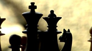 stock-footage-chess-king-queen-radial-dolly-track-shot-in-the-dark